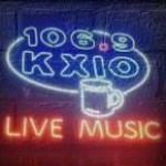 Logo da emissora Radio KXIO 106.9 FM