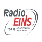 Logo da emissora EINS 100.6 FM
