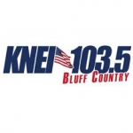 Logo da emissora Radio KNEI 103.5 FM