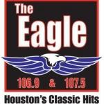 Logo da emissora KGLK The Eagle 107.5 FM