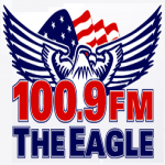 Logo da emissora KXGL 100.9 FM The Eagle