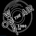 Logo da emissora WNRI 1380 AM