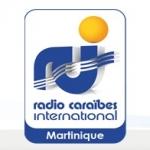 Logo da emissora RCI Martinique 98.7 FM