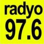 Logo da emissora Plus 97.6 FM
