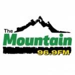 Logo da emissora KMTN 96.9 FM