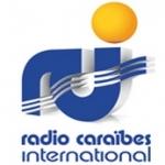 Logo da emissora Radio Caraibes International 98.6 FM
