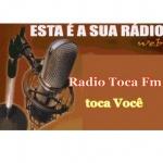Logo da emissora Rádio Toca FM