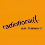 Logo da emissora Radio Flora 106.5 FM