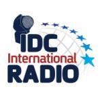Logo da emissora IDC International Radio 106.2 FM