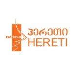 Logo da emissora Radio Hereti 102.8 FM
