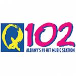 Logo da emissora Radio WNUQ 102.1 FM