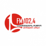 Logo da emissora Radio One 102.4 FM