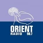 Logo da emissora Orient Radio 98.7 FM